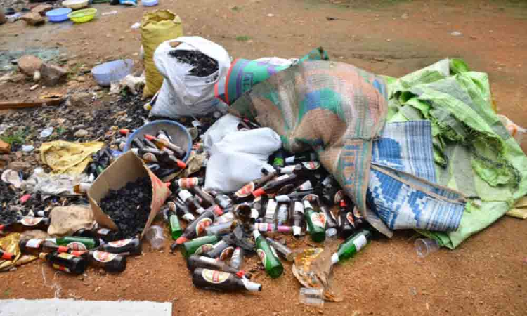 Wanaparthy: Littered wine bottles at Jurala Project irk Collector
