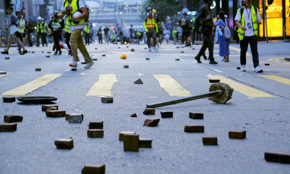 China rejects HK court ruling against anti-mask law