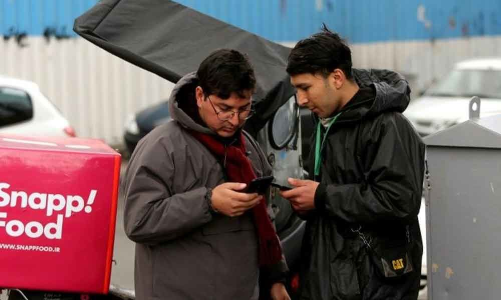 Internet outage forces Iranians to resort to old ways