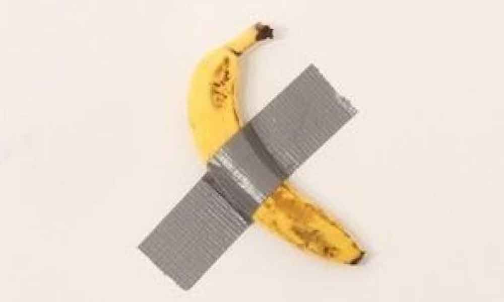 Artist puts banana taped on wall on sale for £91,000