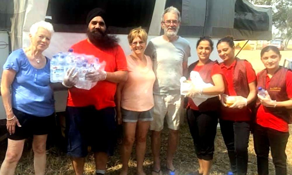 Amid raging bushfires in Australia, Indian couple works overtime by providing food to victims