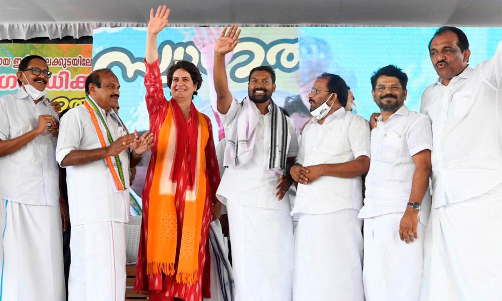 Congress leader Priyanka Gandhi Vadra waves at the crowd during a public meeting for Kerala Assembly polls, at Irinjalakuda, Thrissur on Wednesday