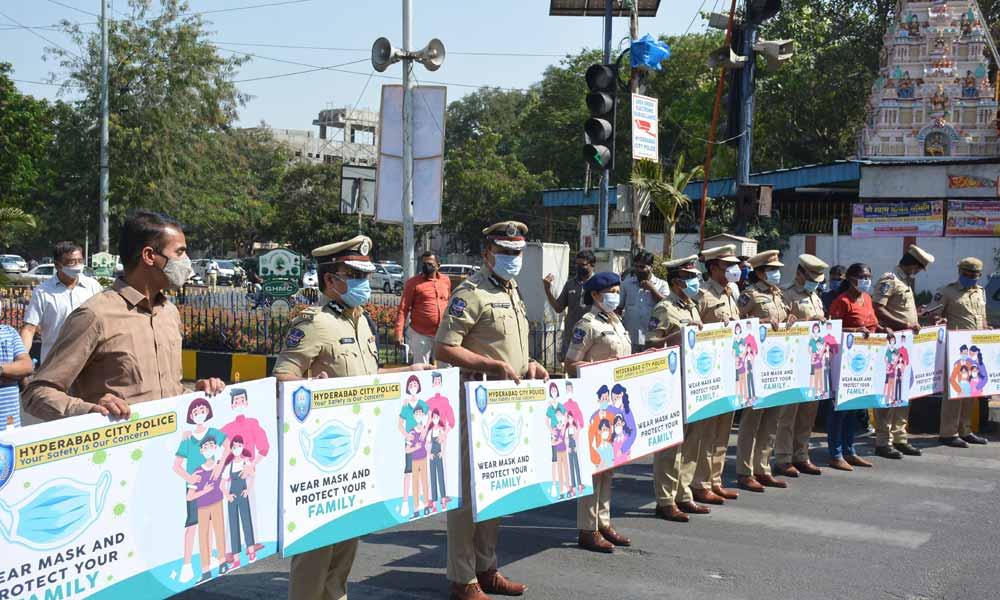 Hyderabad City PC Anjani Kumar leads mask awareness drive