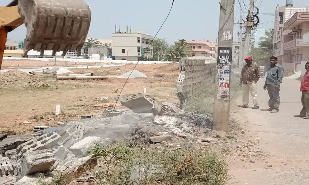 Illegal compound wall demolished