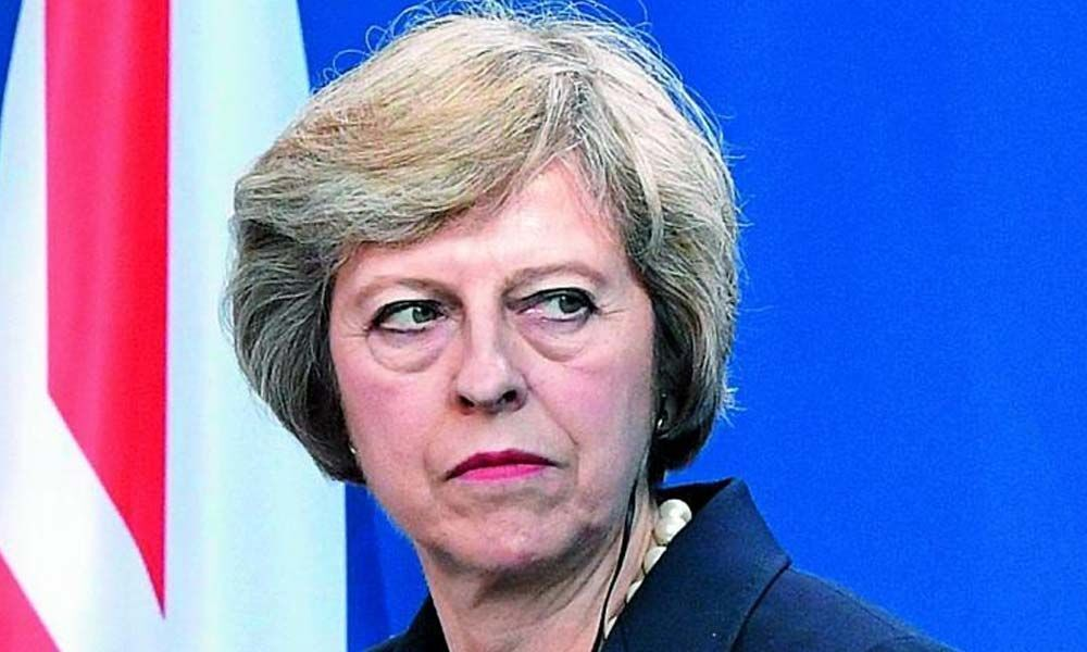 Will resign if Parliament passes Brexit deal, says UK PM Theresa May