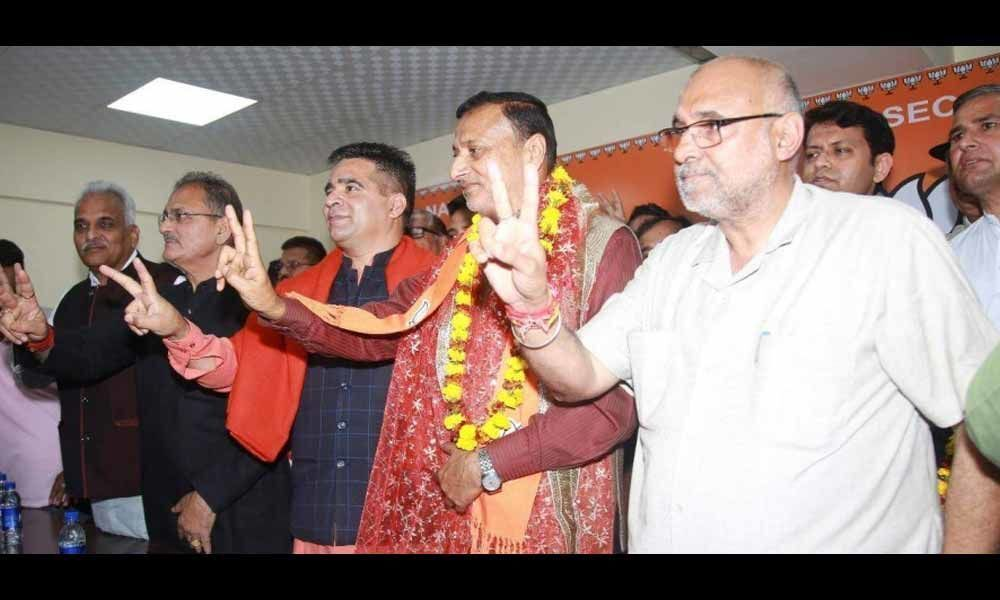 Former Jammu and Kashmir Congres minister Sham Lal Sharma joins BJP