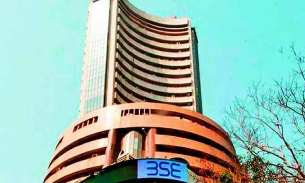 Sensex rises over 200 pts on positive global cues