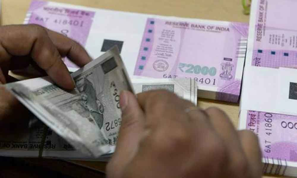 Rupee rises by 12 paise to 69.05 vs USD in early trade