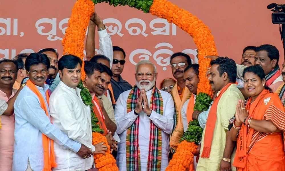 Let lotus bloom for development: Modi