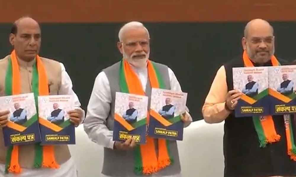 BJP manifesto: Promises to build Ram temple, announces a slew of welfare schemes