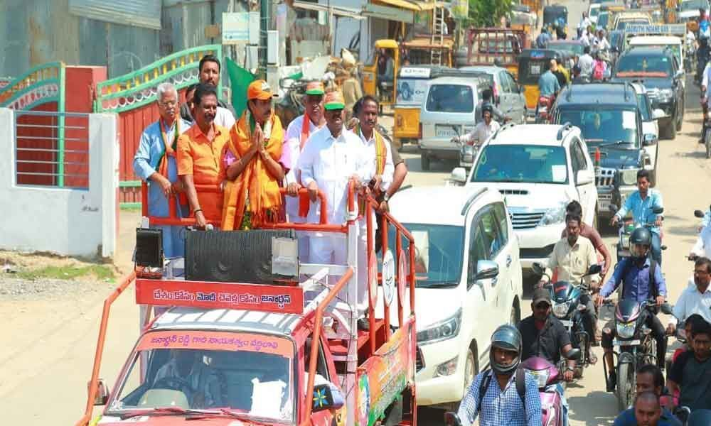 Bjp candidate interacts with locals in Serilingampally