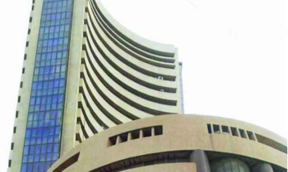Sensex, Nifty end lower after IMF cuts global growth estimate