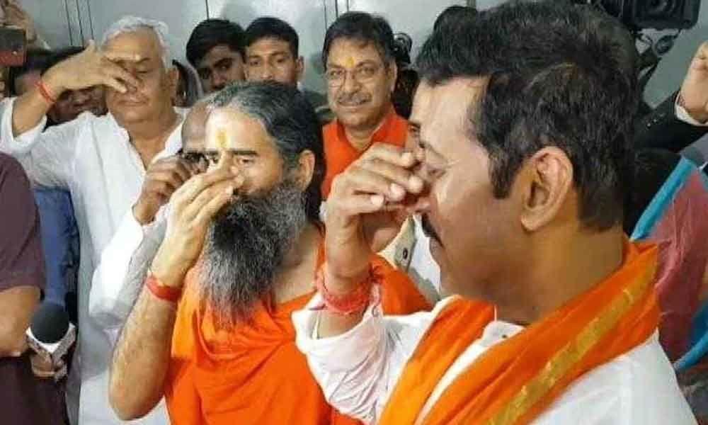 Ramdev performs yoga antics as Rajyavardhan Singh Rathore files papers