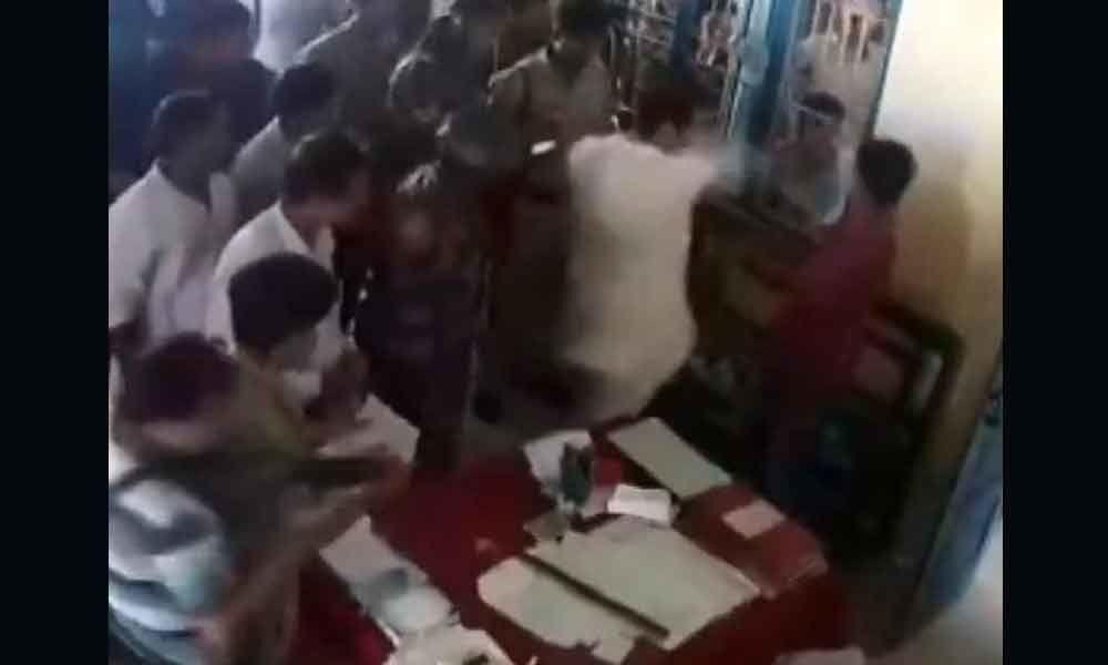 Video: Tripura Cong Prez slaps man in police station for attacking sister