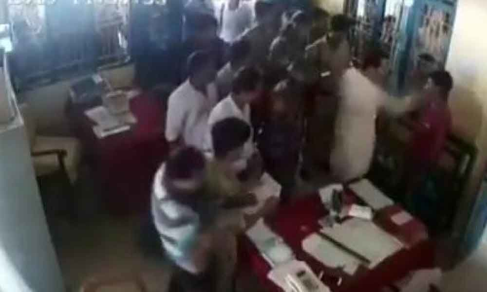 Watch: Tripura Congress chief booked for slapping man in police station