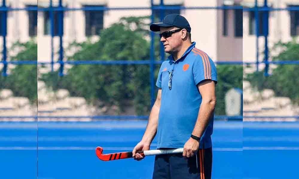 First day in office, hockey coach Reid asks players to put team first