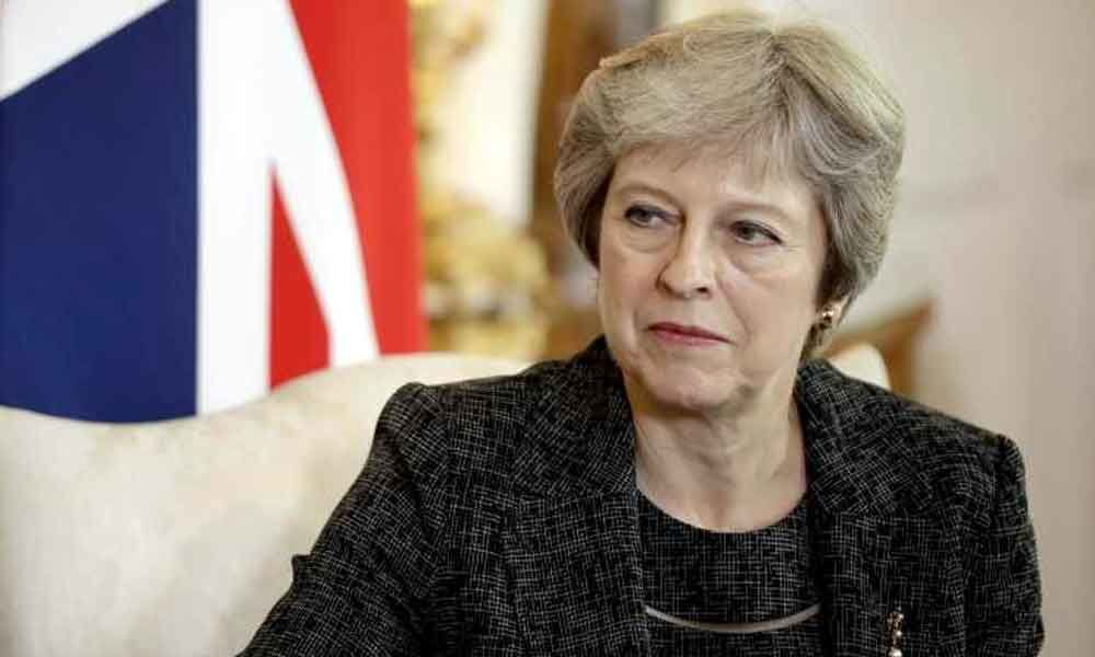 Theresa May sacks defence minister over Huawei leak