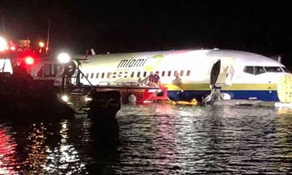 Boeing 737 slides, falls into river with 136 people on board