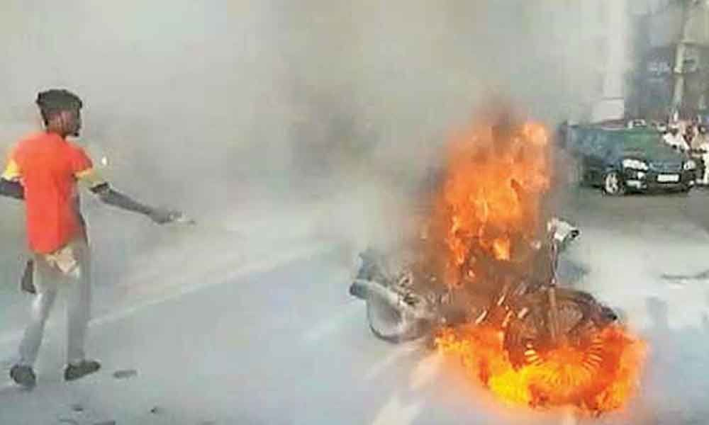 Moving bike catches fire in Hyderabad