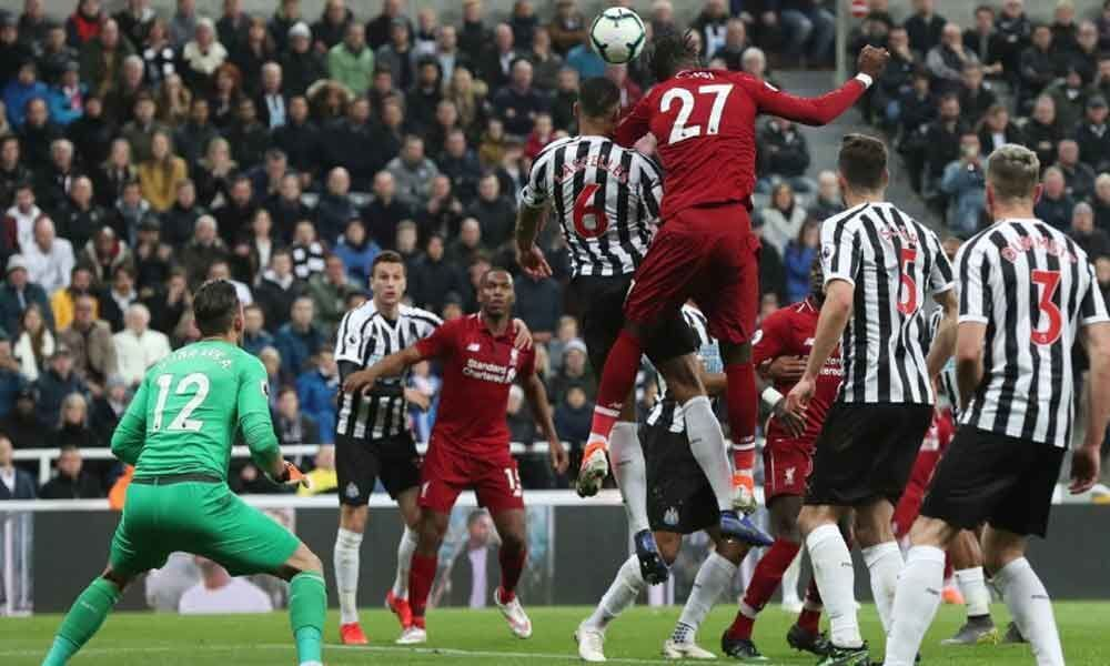 Soccer: Liverpool keep pressure on City; Cardiff relegated