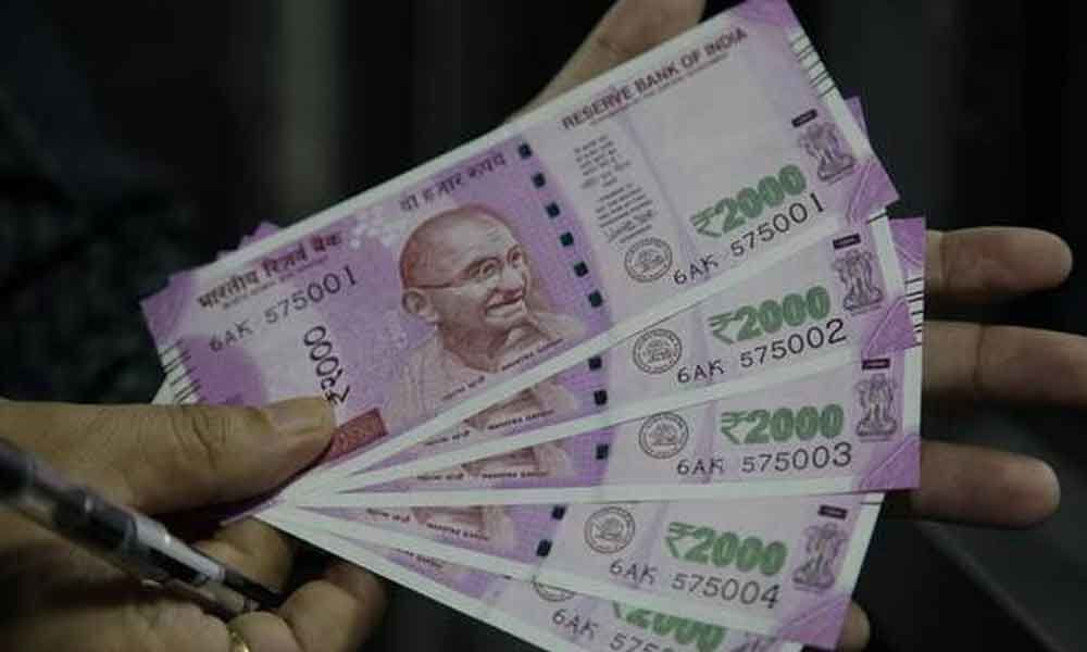 Rupee slips 13 paise to 70.07 vs USD in early trade