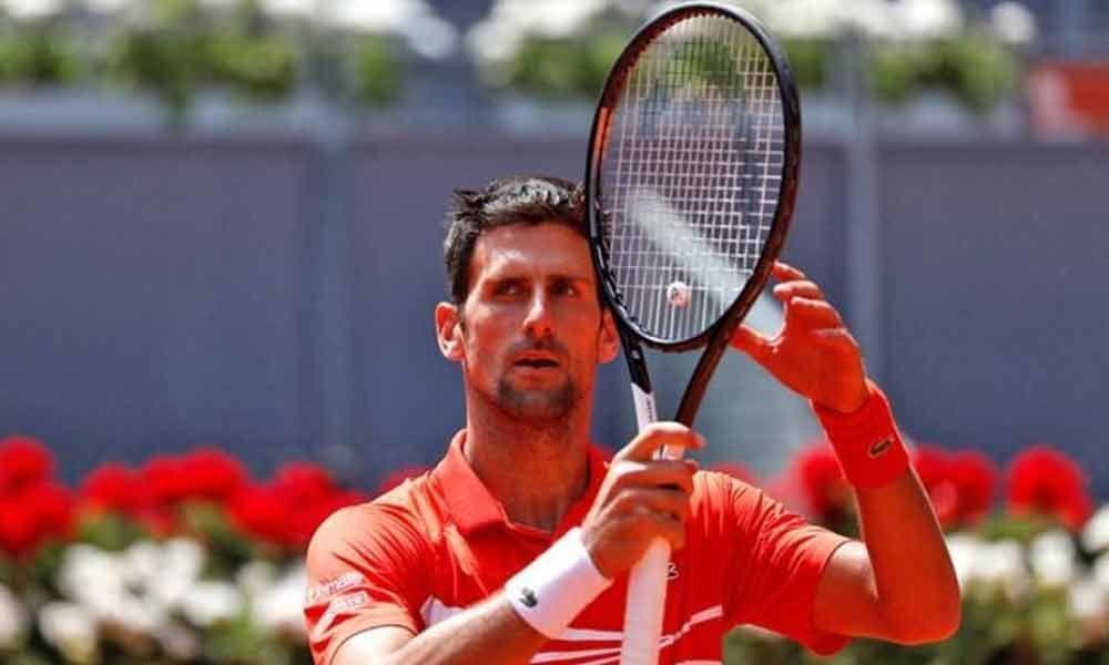 Djokovic into Madrid semis as Cilic withdraws ill