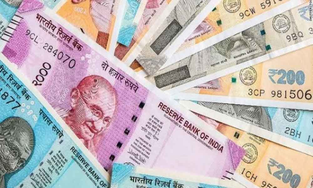 Rupee gains 23 paise to 70.21 vs USD in early trade
