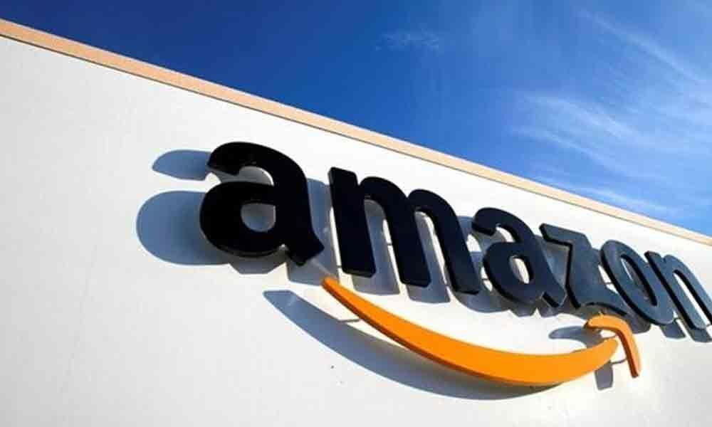 1 lakh Indian traders sell products online: Amazon JV