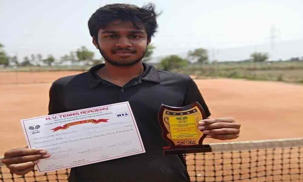 Preetham wins trophy in Tennis under 18 category