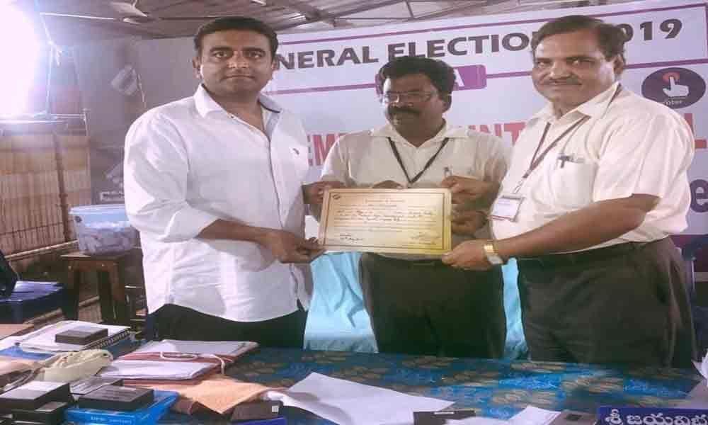 Kasu Mahesh Reddy receives election declaration from returning officer