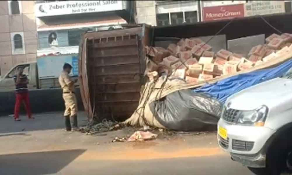 Lorry with beer load overturned at Begumpet