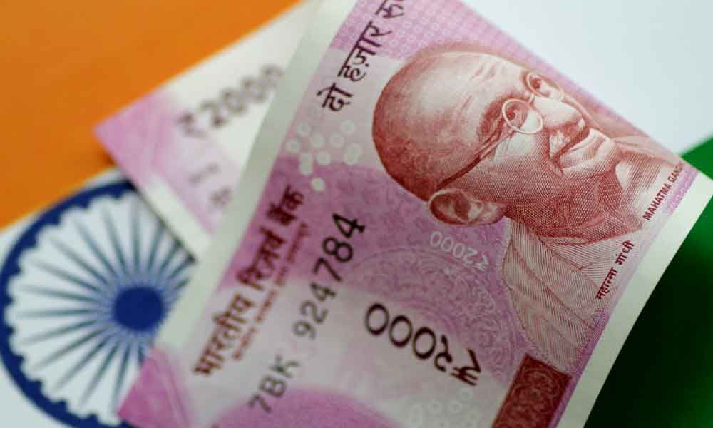 Rupee slips 22 paise to 69.73 vs USD in early trade