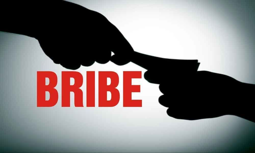 VRO caught by ACB while taking bribe in Mahabubabad