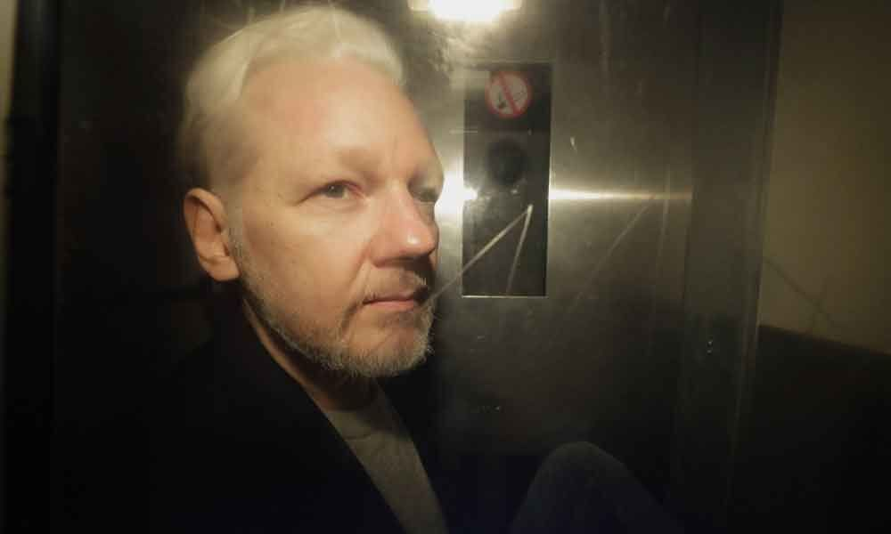 Assange suffering psychological torture, would face show trial in US