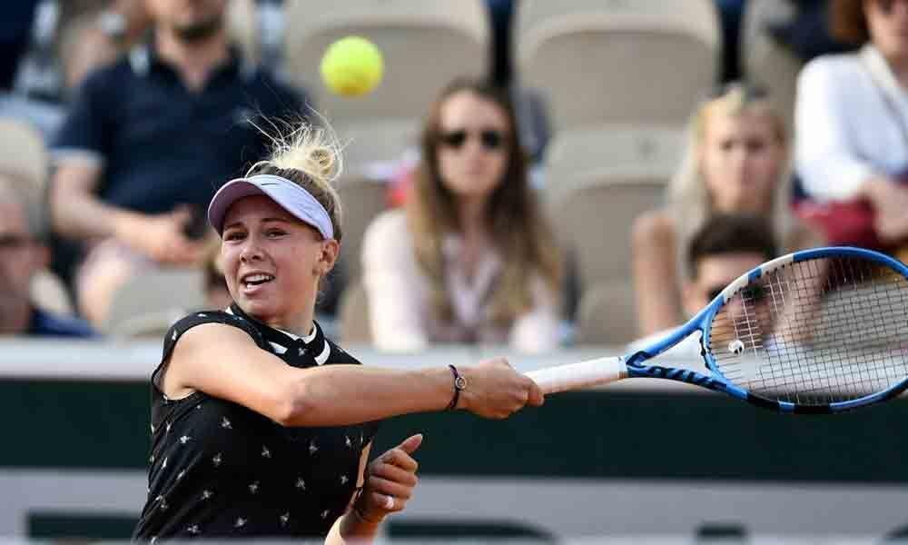 Anisimova stuns Halep to reach French Open semis