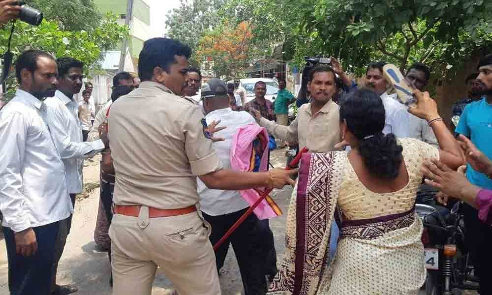 Defected Congress MPTCs face slipper attack in Narsampet