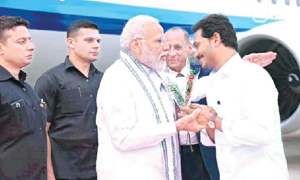 CM Jagan bends, lends ear to Modi