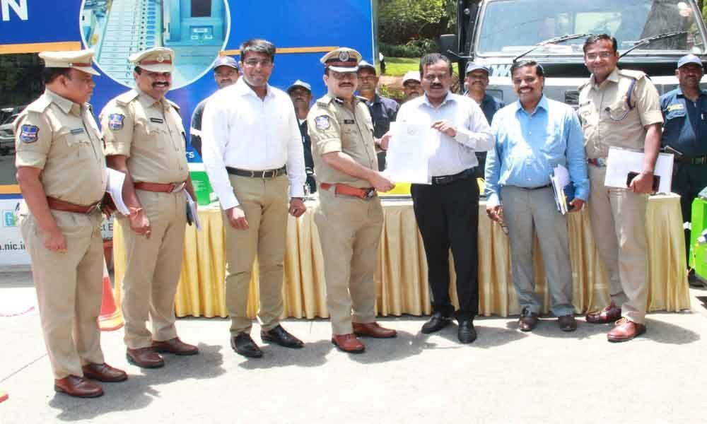 GHMC gifts equipment to traffic police