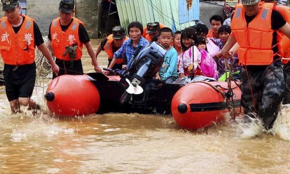 Heavy rains in southern China leave 49 dead, 14 missing