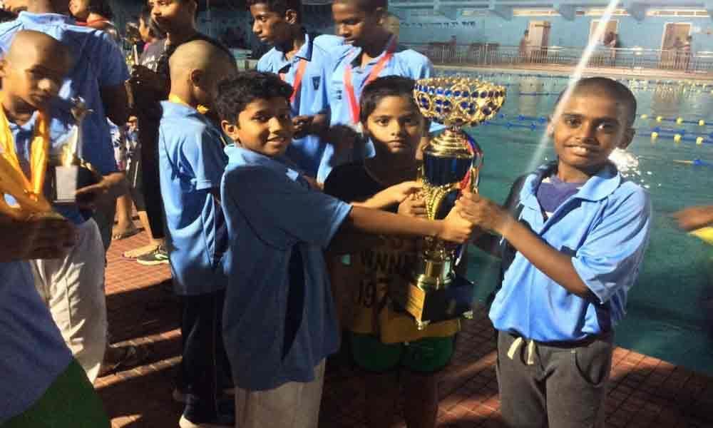 City student wins medals in aquatics