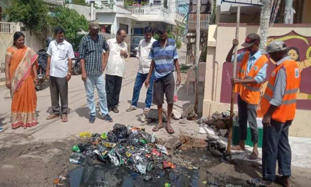 People urged not to throw garbage in drains