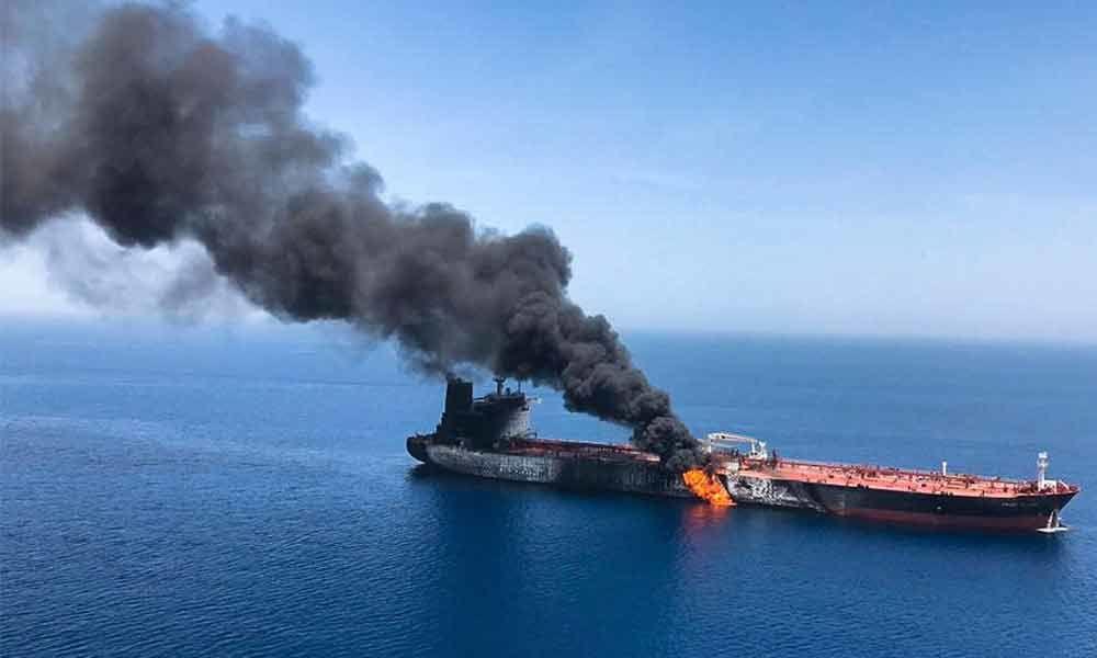 2 tankers catch fire in Gulf