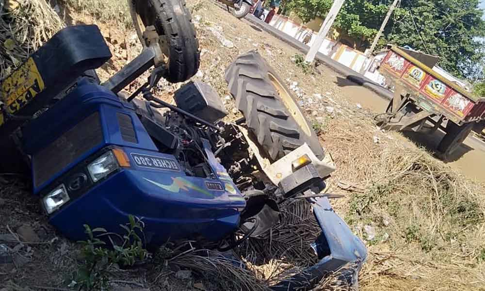 Two killed as lorry hits a tractor