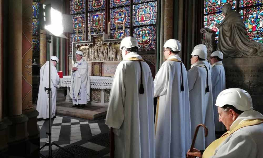 Devotees in safety hats attend Notre-Dames first mass since fire