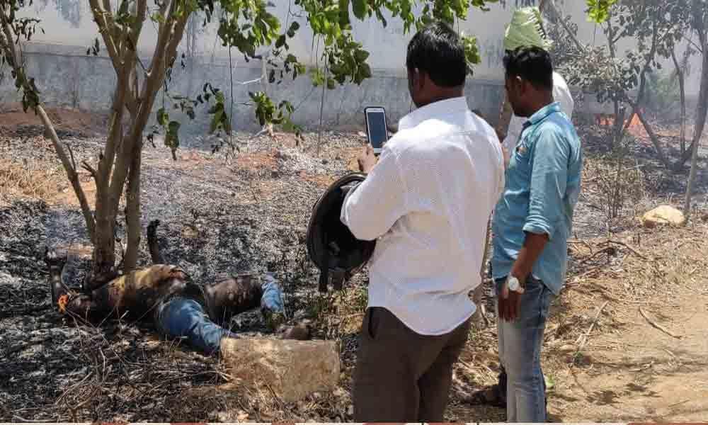 Unidentified man sets himself ablaze on national highway in Shadnagar