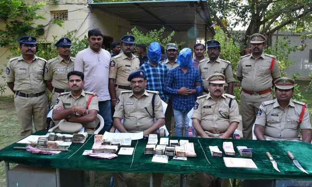 2 held in serial robbery cases