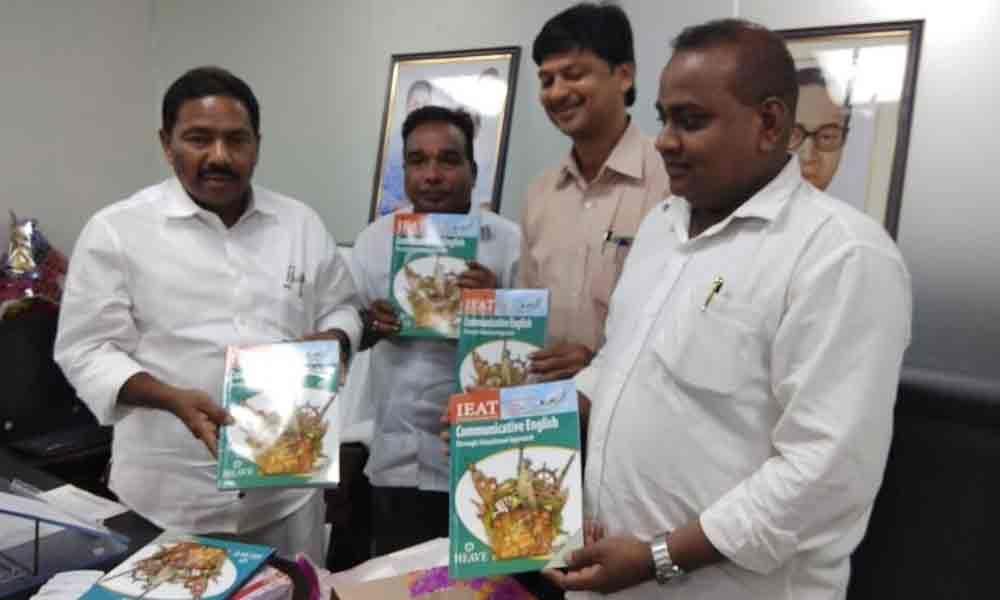 Minister Vishwaroop releases IEET book