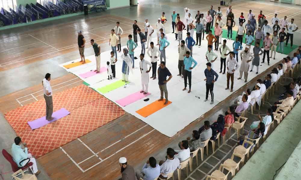 MANUU staff, students observe Yoga Day