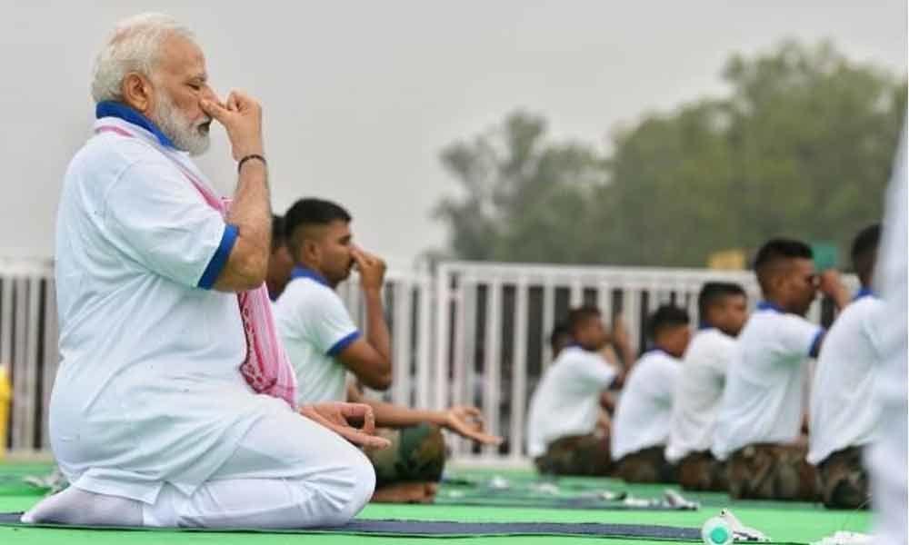 Yoga beyond religion and unites people, says PM Modi