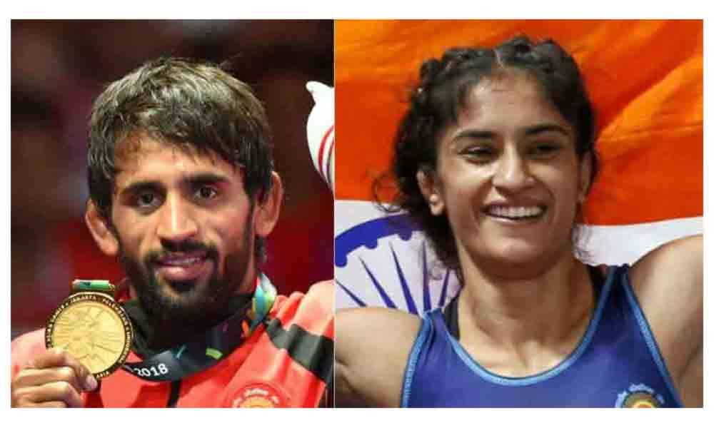 Punia, Phogat slam Haryanas cash reward policy